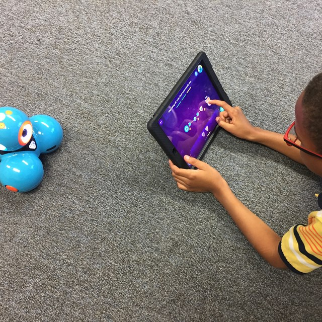 Students use tablets to explore coding and robotics!